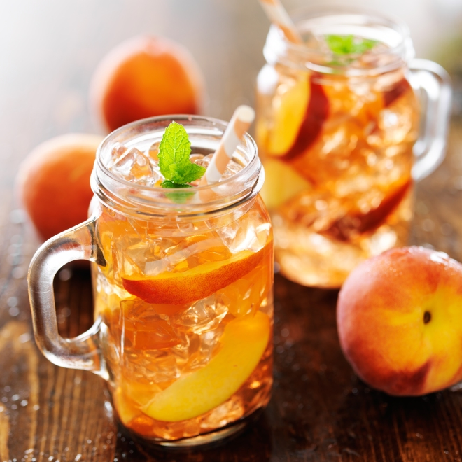 jar of peach tea with striped straw